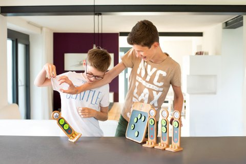 2 guys wrestle in fun for the best household tasks on the taskboard
